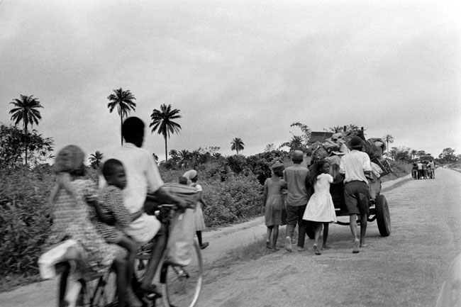 In this file photograph taken on August 28, 1968, civilians flee Aba to go to Umuahia, the new capital of the Republic of Biafra, as the Nigerian federal troops advance toward the city during the Biafran war. Francois Mazure / AFP
