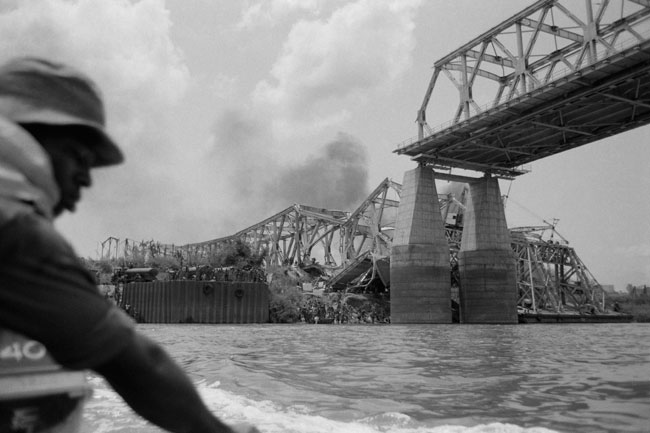 In this file photograph taken on March 31, 1968, The Onitsha bridge, one of the most important communication pathways of West Africa, is destroyed by the Biafran Forces, on the Niger River at Onitsha in south-eastern Nigeria. Colin HAYNES / AFP