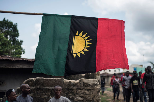 In this file photograph taken on May 28, 2017, supporters of the Indigenous People of Biafra (IPOB) march through the Osusu district in Aba. STEFAN HEUNIS / AFP