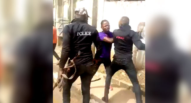 VIRAL VIDEO: Police Officers Arrested After Beating Up Bus Passenger, Confiscating His Phone In Enugu