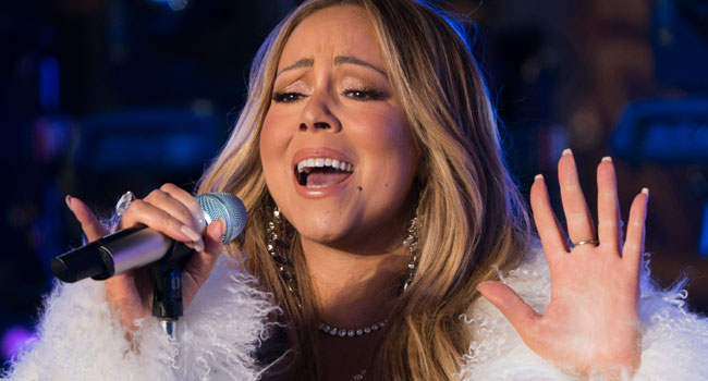 Mariah Carey, first artist with No. 1 hits in four different decades