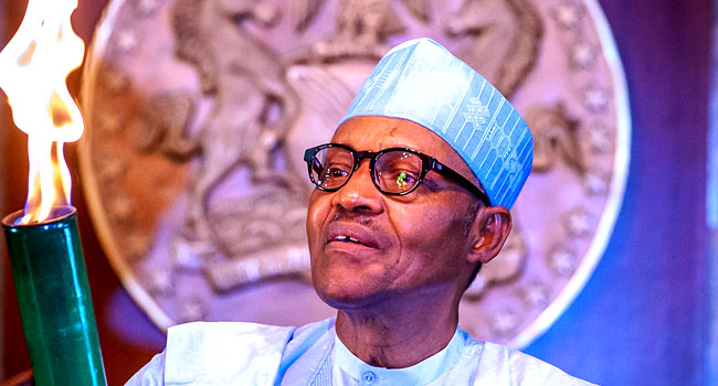 PHOTOS: Buhari Lights 'Torch Of Unity' For National Sports Festival