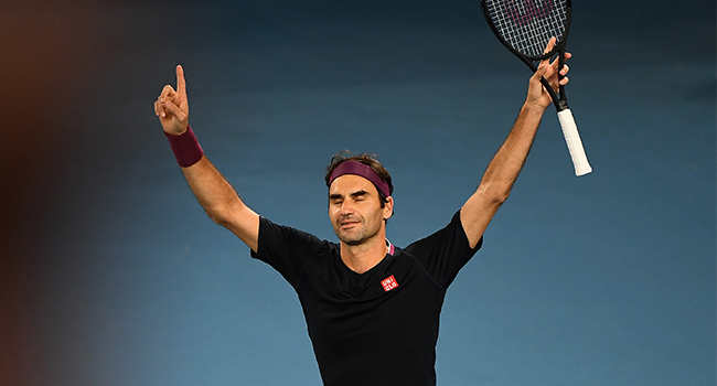 Switzerland's Roger Federer celebrates after victory against Australia's John Millman during their men's singles match on day five of the Australian Open tennis tournament in Melbourne on January 24, 2020. William WEST / AFP