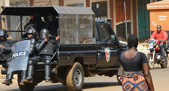 Guinean police patrol in Conakry on January 14, 2020, on the second day of open-ended protests against the president's suspected bid to prolong his rule. CELLOU BINANI / AFP