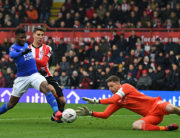 Brentford's English goalkeeper Luke Daniels (R) saves at the feet of Leicester City's Nigerian striker Kelechi Iheanacho (2nd L) during the English FA Cup fourth round football match between Brentford and Leicester City at Griffin Park in west London on January 25, 2020. DANIEL LEAL-OLIVAS / AFP