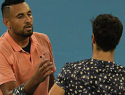 Australia's Nick Kyrgios (L) prepares to shake hands with Russia's Karen Khachanov after victory during their men's singles match on day six of the Australian Open tennis tournament in Melbourne on January 25, 2020. Greg Wood / AFP