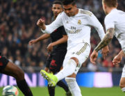 Real Madrid's Brazilian midfielder Casemiro (C) vies with Sevilla's French defender Jules Kounde (L) during the Spanish league football match between Real Madrid CF and Sevilla FC at the Santiago Bernabeu stadium in Madrid on January 18, 2020. GABRIEL BOUYS / AFP