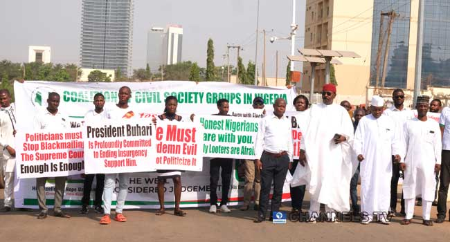 PHOTOS: Stay Out Of Nigeria's Domestic Affairs, Pro-Buhari Protesters Tell International Community