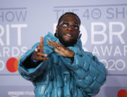 Nigerian singer-songwriter Burna Boy poses on the red carpet on arrival for the BRIT Awards 2020 in London on February 18, 2020. (Photo by Tolga AKMEN / AFP)