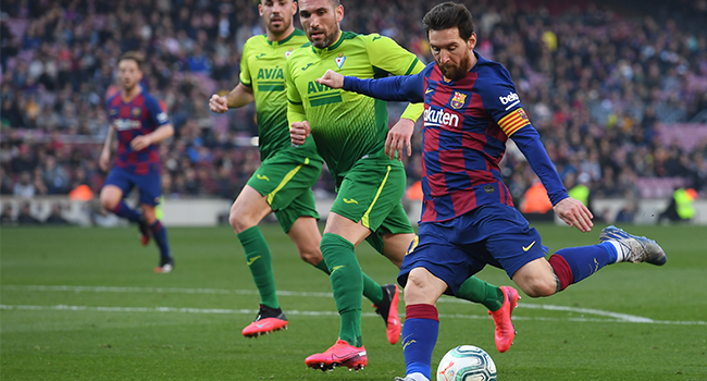 Barcelona's Argentine forward Lionel Messi (R) kicks the ball during the Spanish league football match FC Barcelona against SD Eibar at the Camp Nou stadium in Barcelona on February 22, 2020. Josep LAGO / AFP
