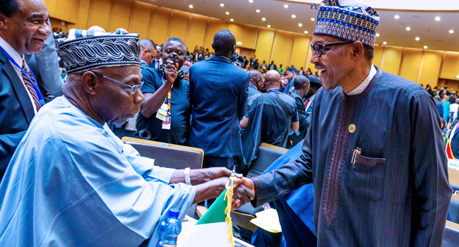 PHOTOS: Buhari Meets Obasanjo, Adesina, Others At AU Summit