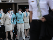 A flight crew from Korean Air, many wearing protective masks, depart the international terminal after arriving at Los Angeles International Airport (LAX) on February 28, 2020 in Los Angeles, California. MARIO TAMA / GETTY IMAGES NORTH AMERICA / AFP