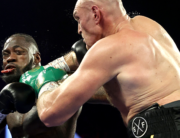 Tyson Fury (R) punches Deontay Wilder during their Heavyweight bout for Wilder's WBC and Fury's lineal heavyweight title on February 22, 2020 at MGM Grand Garden Arena in Las Vegas, Nevada. Al Bello/Getty Images/AFP