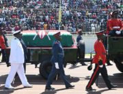 Military officers escort a gun carriage carrying the coffin of late former Kenya President, Daniel Arap Moi, draped in the Kenya national flag, during a state memorial service in Nairobi, on February 11, 2020. SIMON MAINA / AFP