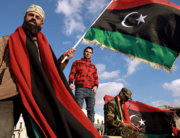 Libyans wave their national flag as they take part in a celebration marking the Libyan revolution, which toppled strongman Moamer Kadhafi, in Benghazi on February 17, 2020. Abdullah DOMA / AFP