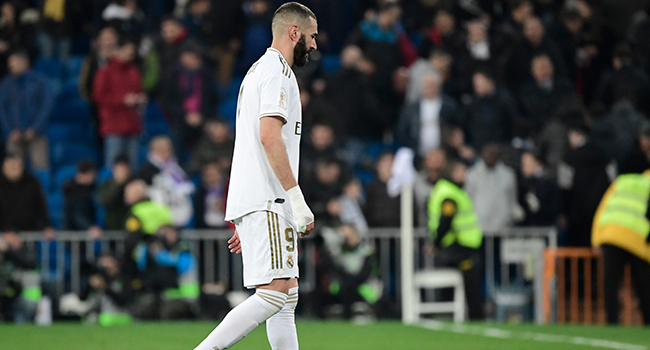 Real Madrid's French forward Karim Benzema leaves the pitch at the end of the Spanish Copa del Rey (King's Cup) quarter-final football match Real Madrid CF against Real Sociedad at the Santiago Bernabeu stadium in Madrid on February 06, 2020. JAVIER SORIANO / AFP