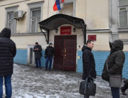 People stand outside the Basmanny Court following an evacuation due to the warning of a planted bomb in Moscow on February 6, 2020. Yuri KADOBNOV / AFP