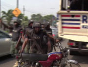 A Lagos state police officer impounds a motorcycle on Saturday, February 1, 2020.