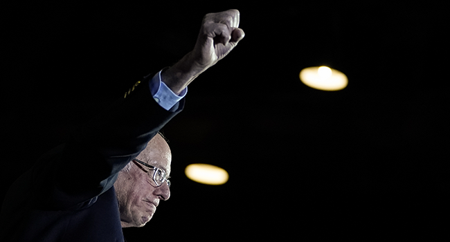 Democratic presidential candidate Sen. Bernie Sanders (I-VT) raises his fist as he arrives onstage after winning the Nevada caucuses during a campaign rally at Cowboys Dancehall on February 22, 2020 in San Antonio, Texas.  Drew Angerer / GETTY IMAGES NORTH AMERICA / AFP