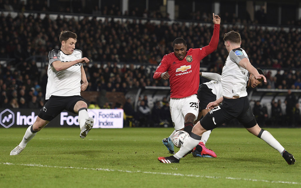 Manchester United Nigerian striker Odion Ighalo scores the team's second goal during the FA Cup fifth round football match between Derby County and Manchester United at Pride Park Stadium in Derby, central England on March 5, 2020. Photo: Oli Scarff / AFP