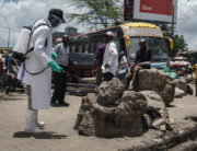 A staff member of Kenya's Ministry of Health sprays disinfectant on a rock which people sit on to curb the spread of the COVID-19 coronavirus at the Gikomba Market in Nairobi, Kenya, on March 21, 2020. - African countries have been among the last to be hit by the global COVID-19 coronavirus epidemic but as cases rise, many nations are now taking strict measures to block the deadly illness. Photo: AFP