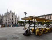 A general view shows a cafe terrace on Piazza del Duomo by the cathedral in downtown Milan on March 10, 2020. Italy imposed unprecedented national restrictions on its 60 million people on March 10, 2020 to control the deadly coronavirus, as China signalled major progress in its own battle against the global epidemic. Miguel MEDINA / AFP