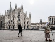 A nun walks across Piazza del Duomo by the cathedral in downtown Milan on March 10, 2020. Italy imposed unprecedented national restrictions on its 60 million people on March 10, 2020 to control the deadly coronavirus, as China signalled major progress in its own battle against the global epidemic. Miguel MEDINA AFP