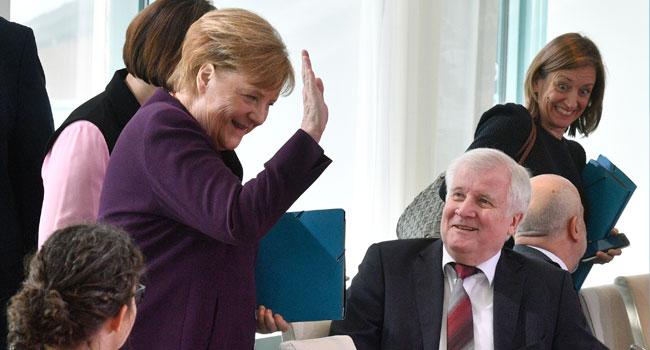 Interior Minister Rebuffs Angela Merkel's Handshake Over Coronavirus