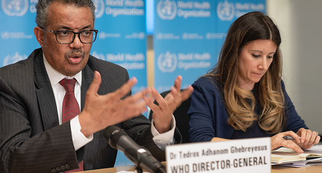 This handout picture made available by World Health Organization (WHO) shows WHO Director-General Tedros Adhanom Ghebreyesus (L) speaking next to WHO Technical Lead Maria Van Kerkhove during a virtual press briefing on the novel coronavirus (COVID-19) virus at the WHO headquaters in Geneva on March 16, 2020. Christopher Black / World Health Organization / AFP