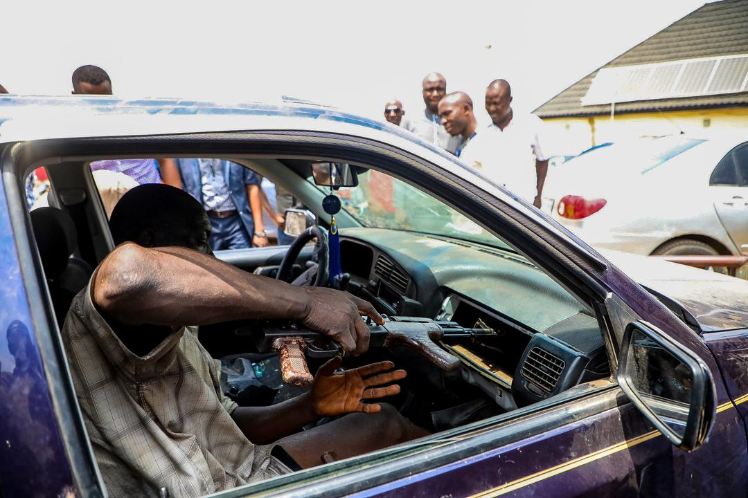 An armed robber displays how he hide guns in a car during a parade by the Special Anti-Robbery Squad of the Nigerian Police Force in Abuja on March 11th, 2020. Photo: Sodiq Adelakun / Channels TV