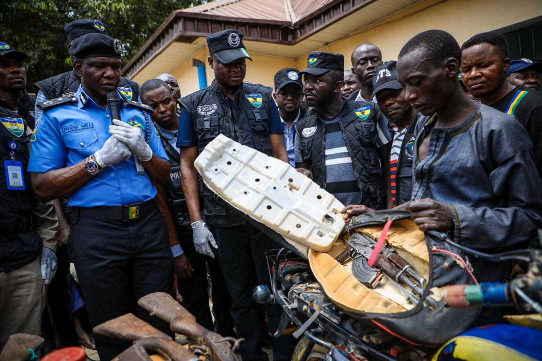 A kidnapper displays how he hide guns in a car during the parade of suspects by the Special Anti-Robbery Squad of the Nigerian Police Force in Abuja on March 11th, 2020. Photo: Sodiq Adelakun / Channels TV