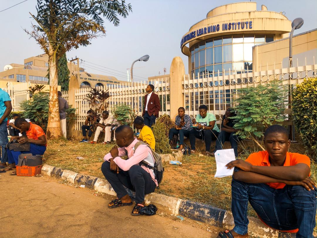 Candidates of the Joint Admissions and Matriculation Board (JAMB) wait outside a JAMB CBT Centre in Abuja on Monday March 16th, 2020. Photo: Sodiq Adelakun/ChannelsTV