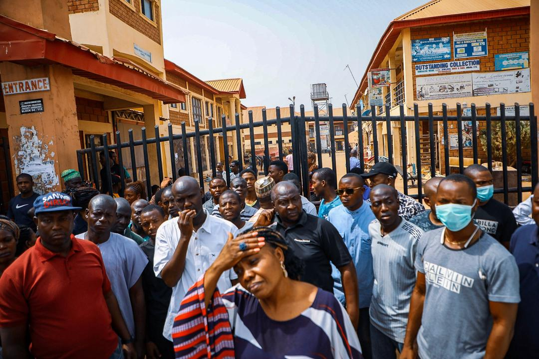 Store owners stand outside their closed stores in Dutse, Abuja after being closedown by task force over unknown cause on Wednesday, March 18th, 2020. Photo: Sodiq Adelakun / Channels TV