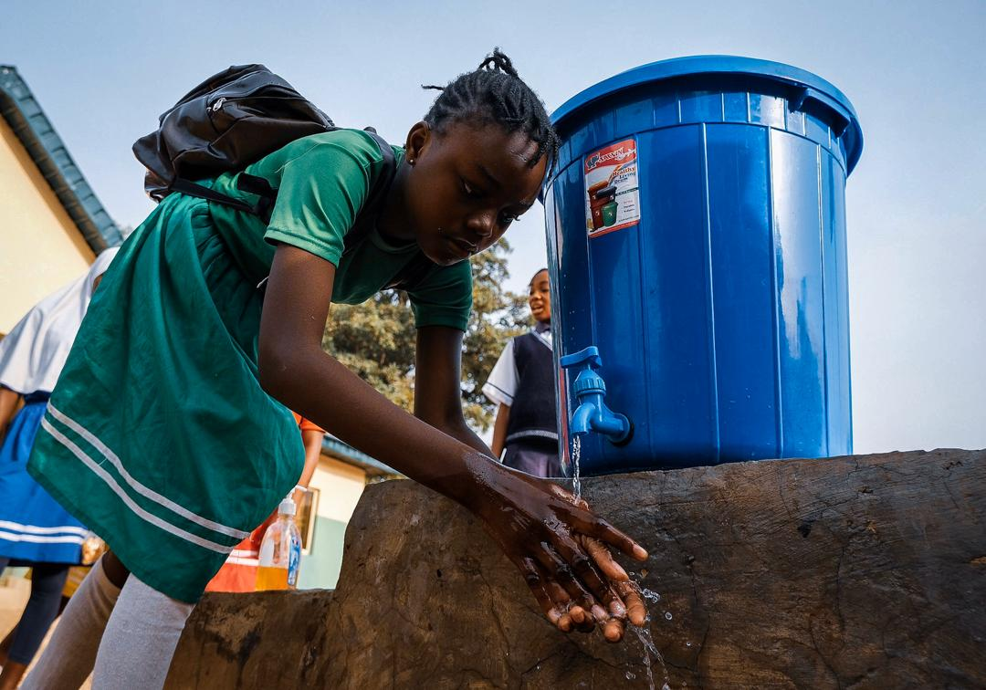 A schoolgirl washes her hand as one of the precautionary measure of preventing the spread of the Corona Virus at a Government Junior Secondary School in Abuja on Friday. March 20th 2020. Photo: Sodiq Adelakun / Channels TV