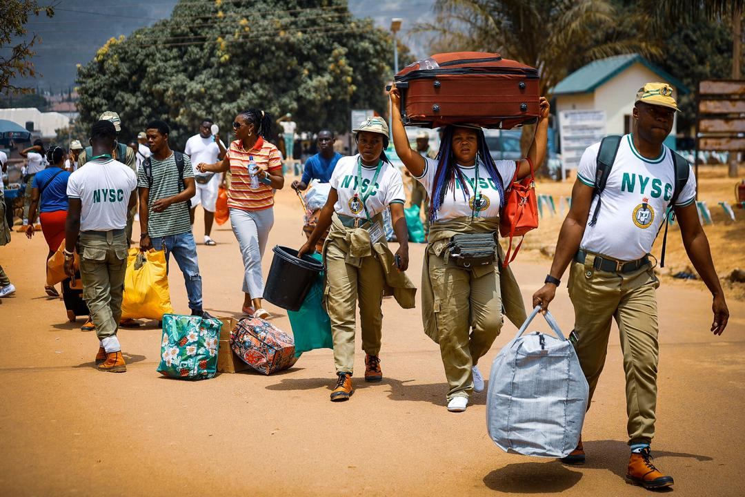 Members of the National Youth Service Corps departs the FCT orientation camp in Kubwa, Abuja on Wednesday, March 18th, 2020. Photo: Sodiq Adelakun / Channels TV