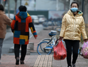 A woman wearing face mask, amid concerns about the spread of the COVID-19 novel coronavirus, walks along a street in Hefei, China's eastern Anhui province on March 9, 2020. NOEL CELIS / AFP