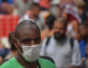 A man wearing a face mask as a preventive measure against the spread of the new coronavirus, COVID-19, walks in downtown Sao Paulo, Brazil on March 16, 2020. NELSON ALMEIDA / AFP