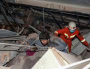 A man (L) is helped by rescuers as he is pulled from the rubble of a collapsed hotel in Quanzhou, in China's eastern Fujian province on March 7, 2020. STR / AFP