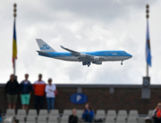 In this file photo A Boeing 747 commercial plane of KLM airline lands at Shipol airport behind spectators watching the European Athletics Championships at the Olympic stadium in Amsterdam on July 6, 2016. FABRICE COFFRINI / AFP