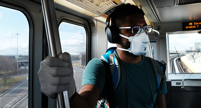 A man wears a medical mask on the AirTrain as concern over the coronavirus grows enroute to John F. Kennedy Airport (JFK) on March 7, 2020 in New York City. Spencer Platt/Getty Images/AFP