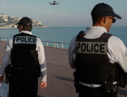 Police officers use a drone to control people on the 'Promenade des Anglais' in the French Riviera city of Nice, on March 19, 2020, on the third day of a strict lockdown in France to stop the spread of COVID-19, caused by the novel coronavirus. VALERY HACHE / AFP