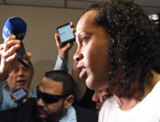 Brazilian retired football player Ronaldinho arrives at Asuncion's Justice Palace to testify about his irregular entry to the country, in Asuncion, on March 6, 2020. Norberto DUARTE / AFP