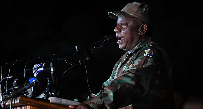 South African President Cyril Ramaphosa dressed in military fatigues talks to soldiers of the South African National Defence Force (SANDF) at the Doornkop Military Base in Soweto, on March 26, 2020, as they get ready to maintain public order during the national lockdown scheduled from March 26, 2020 until April 16, 2020 to prevent the spreading of the COVID-19 coronavirus outbreak in South Africa. AFP