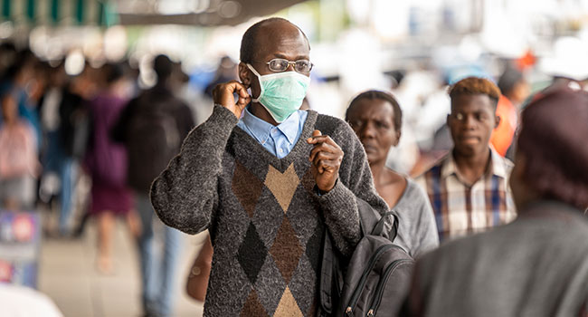 A man walks in the streets wearing a face mask as a preventive measure agaisnt the spread of COVID-19 coronavirus on March 23, 2020, in Bulawayo, Zimbabwe. ZINYANGE AUNTONY / AFP
