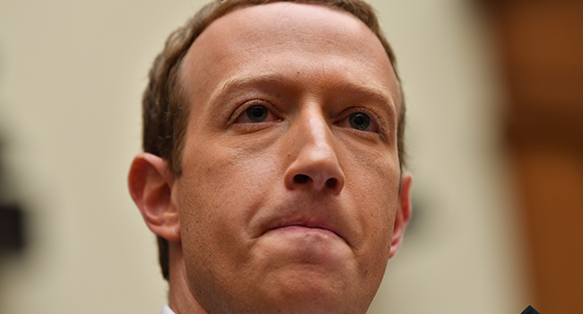 "In this file photo taken on October 23, 2019 Facebook Chairman and CEO Mark Zuckerberg testifies before the House Financial Services Committee on ""An Examination of Facebook and Its Impact on the Financial Services and Housing Sectors"" in the Rayburn House Office Building in Washington, DC. Nicholas Kamm / AFP"