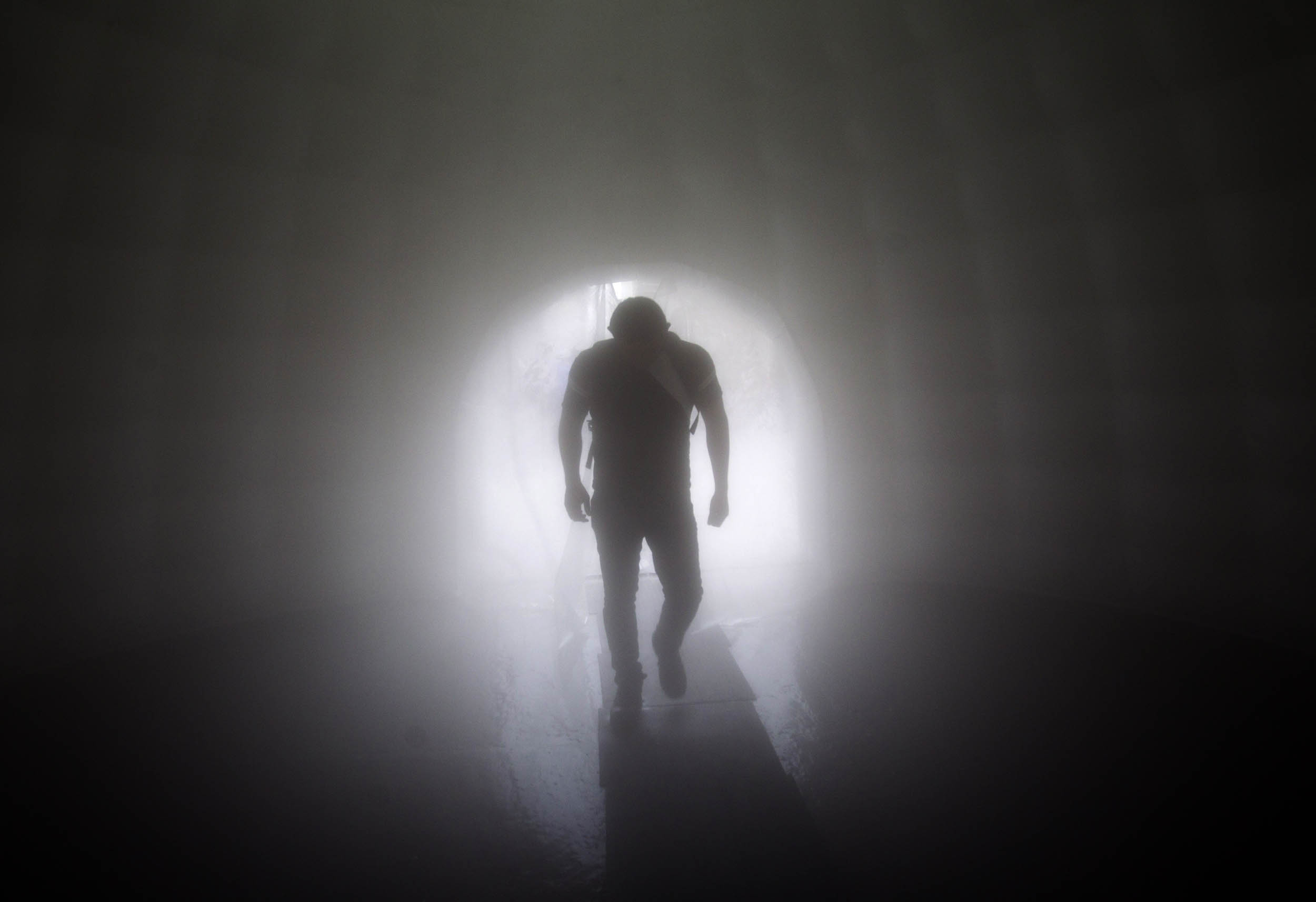 A man walks through a sanitizing tunnel installed outside a subway station in Escobedo, Nuevo Leon, Mexico, on March 29, 2020 as a preventive measure against the spread of the new coronavirus, COVID-19. - The smart cabin consists of an inflatable unit in a circular shape that is permanently spraying a sanitizing product used in hospitals. Photo: Julio Cesar Aguilar