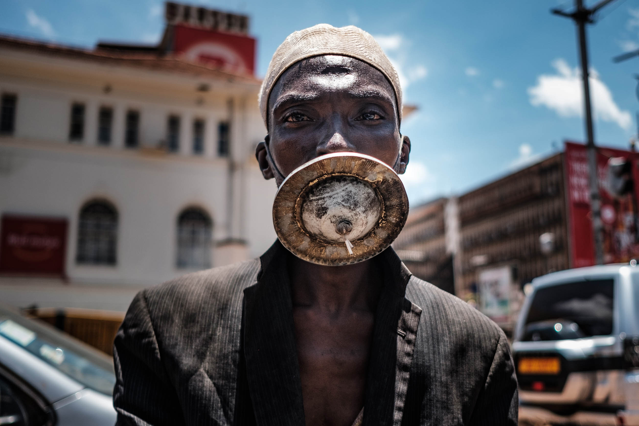 A man wearing an alternative mask poses for a photograph in Kampala, on April 1, 2020. - Ugandan President Yoweri Museveni on March 30, 2020, ordered an immediate 14-day nationwide lockdown in a bid to halt the spread of the COVID-19 coronavirus which has so far infected 33 people in the country. Photo: Sumy Sadurni / AFP