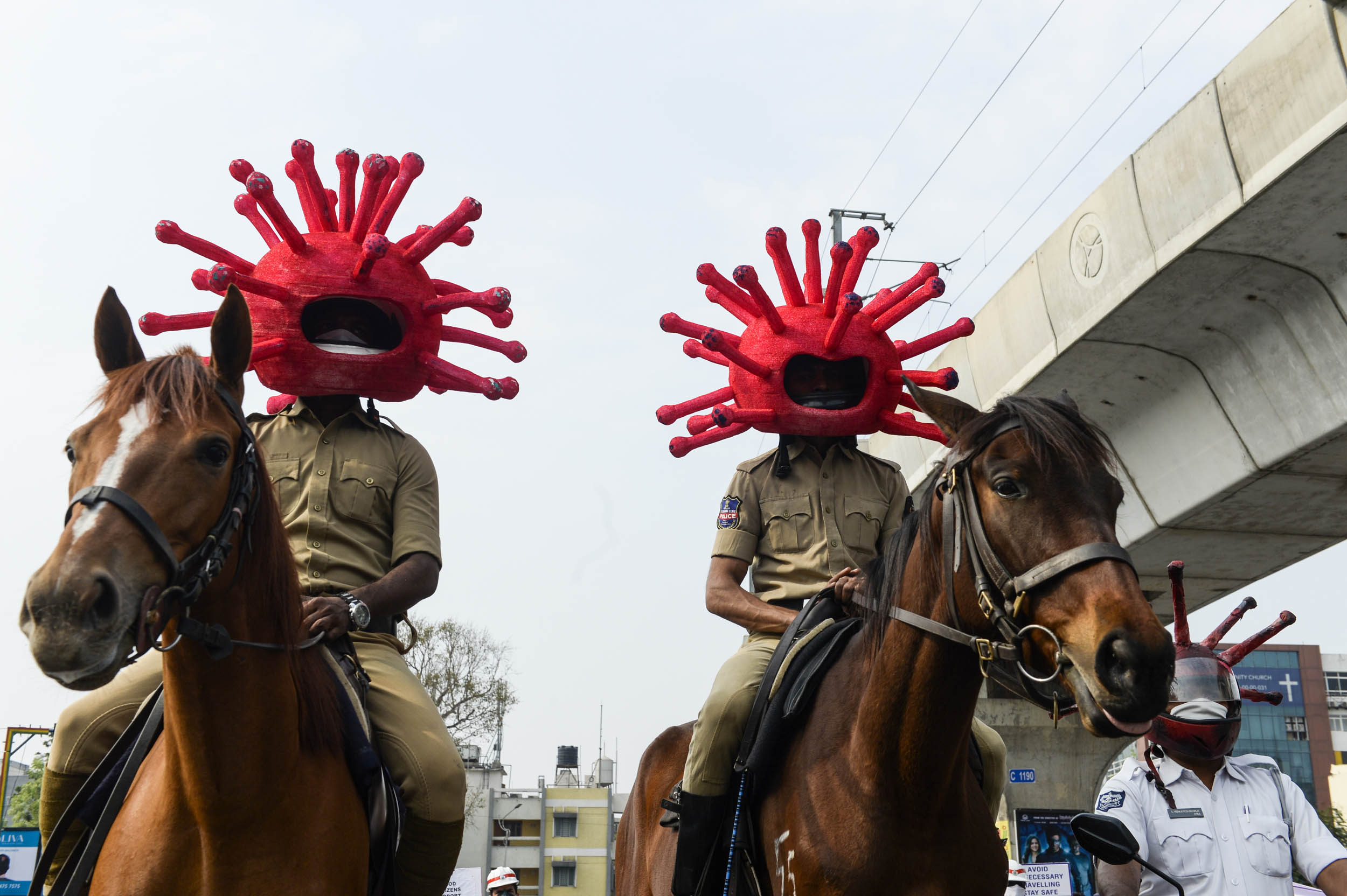 Police personnel wearing coronavirus-themed helmets ride on horses as they participate in a awareness campaign during a 21-day government-imposed nationwide lockdown as a preventive measure against the COVID-19 coronavirus in Secunderabad, the twin city of Hyderabad, on April 2, 2020. Photo: Noah Seelam / AFP