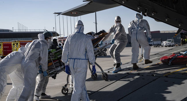 Coronavirus Death Toll Rises 63,437 Worldwide