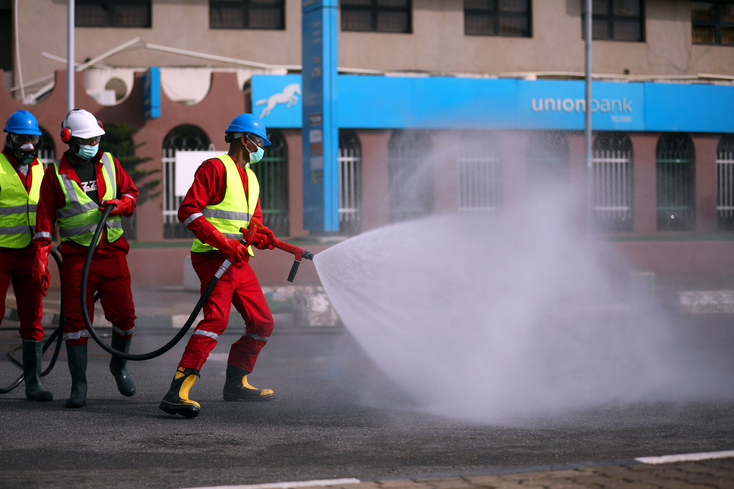 Fire service crews decontaminate the street on the third day of a 14-day lockdown aimed at limiting the spread of coronavirus disease (COVID-19), in Abuja, Nigeria April 2, 2020. Photo: Sodiq Adelakun / Channels TV